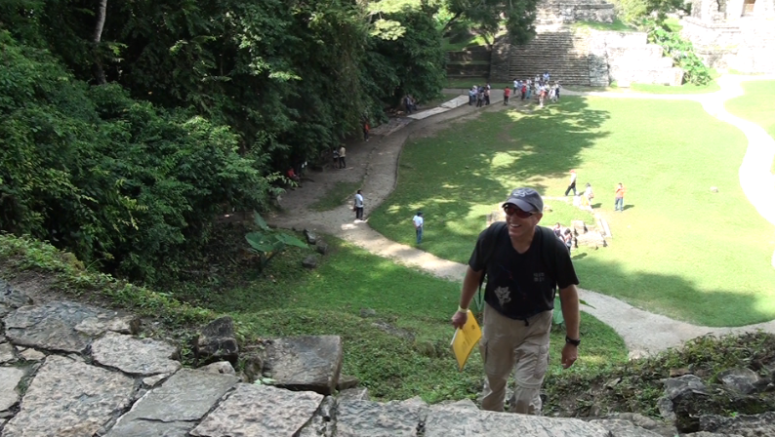 Joe Orr arrives at top of Temple of the Foliated Cross, Palenque, Maya Field Workshop, 2012.